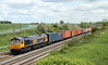 30 May 2015. With the sun just about making an appearance 66763 takes a fully loaded 4M23 1034 Felixstowe - Hams Hall past Castlethorpe.