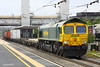 29 May 2015. With a patch painted front end 66572 takes a half loaded 4M54 1010 Tilbury - Crewe through Bletchley.