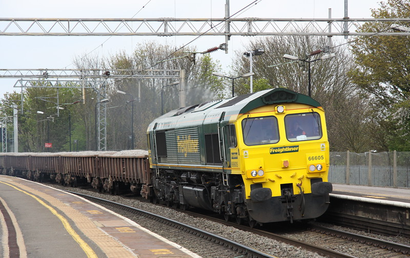 2 May 2015. With a freshly repainted cab and also sporting new light clusters 66605 passes Wolverton with the 6Y60 057 Bescot -Bourne End. This working left Bescot on time but is seen here running over two hours late due to vandalism around Canley near Coventry. The vandalism resulting in London Midland running only as far as Coventry and cancellation of Virgin services to Birmingham New Street.
