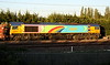 20 May 2015. With the palisade beautifully unlit in shadow, colourful 66720 is seen side on in the setting sun passing Stoke Hammond with the 6L48 1549 Garston - Dagenham empty cartics.
