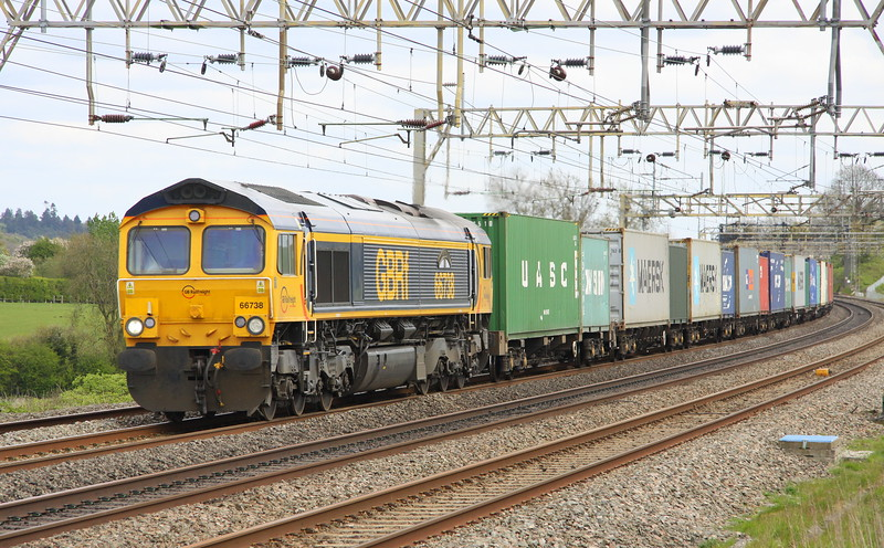 1 May 2015. Football freight as 66738 HUDDERSFIELD TOWN glides past Soulbury on the 4M23 1046 Felixstowe - Hams Hall.