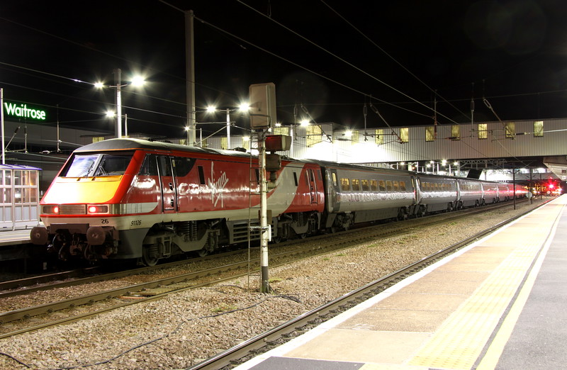 14 May 2015. Virgin East Coast liveried 91126 awaits time at Peterborough whilst working the 1Y53 2115 Newcastle - King's Cross.