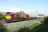 9 May 2015. With stone dust on the roof of 66175 as well as in the wagons, the 6B10 0219 Peak Forest - Bletchley runs past Bradwell running just over an hour late.