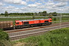 30 May 2015. DB red 66152 Derek Holmes Railway Operator powers south past bridge 183 at Castlethorpe with the 6O67 1405 Daventry - Dollands Moor vans.