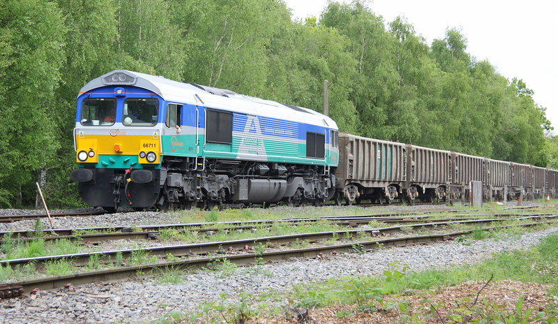 22 May 2015. Alas no sun as Aggregate Industries liveried 66711 arrives at Calvert with the 6M92 1217 ex Willesden..