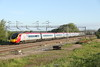 30 May 2015. Nine car 390039 Virgin Quest running ECS past Gordon's Lodge with the 5A12 0419 Longsight Carriage MD - Euston.