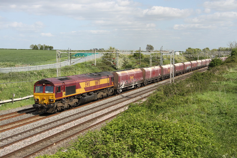 16 May 2015. With a rake of HTA's in tow 66175 powers past Castlethorpe with the 4Z34 1237 Acton Yard - Peak Forest.