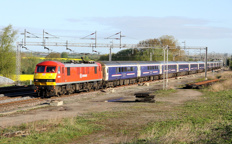 4 May 2015. Carrying its fourth livery since construction, 90018 leads the retimed Highland sleeper, the 1M16 2026 Inverness - Euston Caledonian sleeper past Gordon's Lodge. The train was retimed due to engineering works around Stafford and hence the service was routed via Manchester. 90018 has previously carried InterCity as built and also Rail express systems and EWS colours.