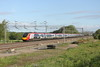 30 May 2015. The uniquely branded 390104 Alstom Pendolino heads north at Gordon's Lodge with the 1H61 0636 Euston - Manchester Piccadilly.