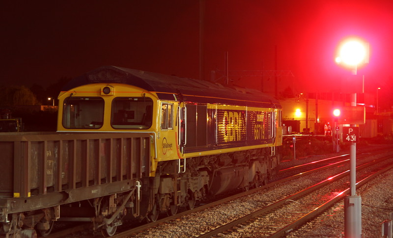 14 May 2015. Red light district at Peterborough as 66719 METRO-LAND awaits the off with the 6M15 2234 Whitemoor - Toton engineers.