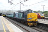 10 May 2015. With 350245 to the left and an Euston bound voyager to the right 37419 Carl Haviland 1954-2012 arrives at MK on the Four Triangles charter, the 1Z46 1244 Euston - Crewe. The charter was running two hours late at this point due to the failure of the second train loco 37059 at Euston. 57310 Pride of Cumbria was on the rear.