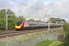 9 May 2015. BUSINESS IS GREAT 390151 Virgin Ambassador heads towards the approaches at MK passing Bradwell on the 1A13 0755 Manchester Piccadilly - Euston.