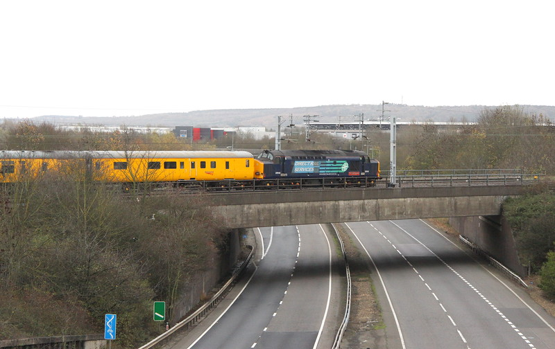 15 November 2015. DRS 37610 T.S.(Ted) Cassady 14.5.61 - 6.4.08 brings up the rear of the test train from Tonbridge. Note the home of MK Dons visible above the loco.