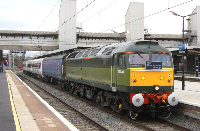 15 November 2015. Fresh from her naming at the NRM in York on 12 November, 47830 BEECHING'S LEGACY passes through Bletchley with SE 375626 in tow working from Acton Lane - Derby for refresh and repaint. 47830 was named to commemorate the 50th anniversary of Freightliner.