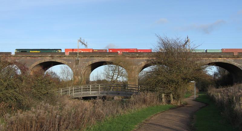 21 November 2015. 66516 crosses Haversham viaduct just north of Wolverton working the 4M93 0846 Felixstowe - Crewe Basford Hall.