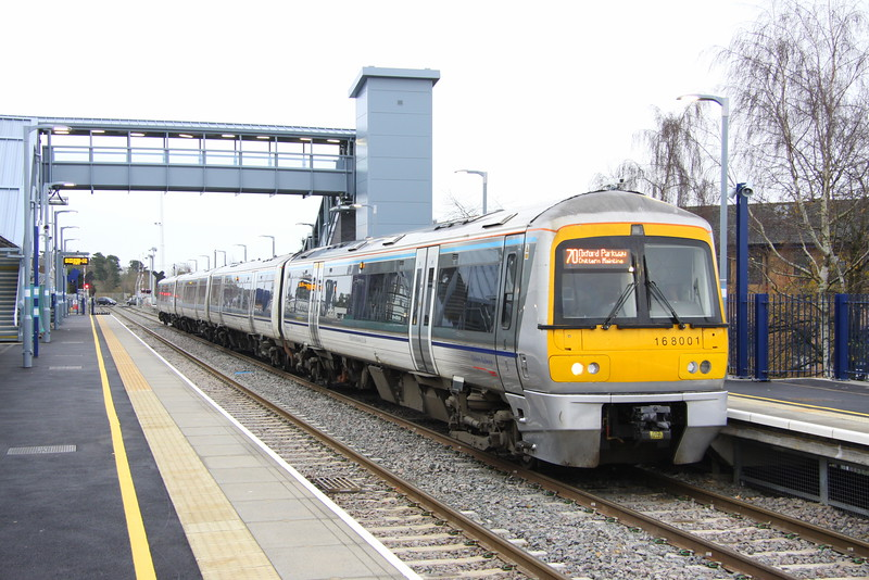 28 November 2015. Pioneer 168, 168001 stands at the recently opened Bicester Village with the 1T23 1035 Marylebone - Oxford Parkway.