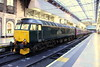 7 November 2015. GWR green machine 57605 Totnes Castle stands at Paddington with the previous nights Night Riviera, the 1A40 2345 Penzance - Paddington. Although now a passenger loco, 47206 was previously a freight loco numbered 47206 and named The Morris Dancer.