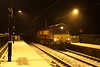 16 January 2016. Just before midnight and with the snow falling fast, 66148 sits just in Wolverton station with five autoballasters as the 6R05 1929 Bescot - Hanslope Junction.