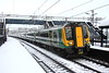 17 January 2016. The only footprints in the snow on platform 1 are those that I made positioning myself for this shot of 350107 + 350106 + 350102 arriving at Wolverton with the 2N00 0853 Northampton - Euston.