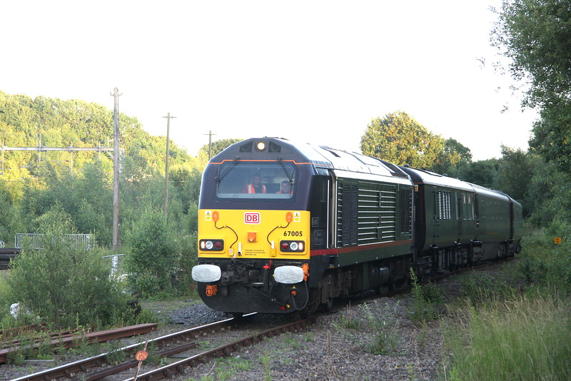 1 July 2016. With the sun shining on the WCMl to the left, 67005 Queen's Messenger leads up the incline and along McConnell Drive towards Wolverton Works with the Royal Train ECS which was returning from Royal duties.