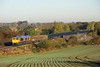 2 November 2016. A beautiful sunny early morning as 66753 Roberts Road EMD trundles past Oakley with the 6V42 0813 Wellingborough - Whatley Quarry. The first three wagons are the older JNA's (3448, 3447 and 3456) followed by brand new VTG wagons.