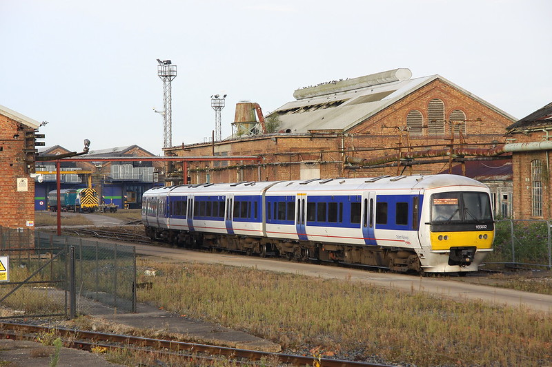 1 October 2016. With an unidentified 319 in the workshop, 165032 is seen entering into Wolverton Works having arrived as the 5M64 0520 ex Aylesbury DMU Depot. Shortly after this image was taken, 165029 made the journey in the opposite direction.