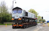 7 April 2017. Hitching a ride to Daventry via Stony Stratford and Towcester as 66428 brings Wolverton traffic to a standstill.