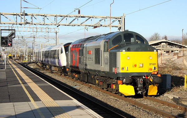 15 December 2017. Rail Operation Group's 37601 Perseus passes non stop through Bletchley with Elizabeth Line branded 345019 in tow working the 5Q72 0955 Old Dalby - Wembley.
