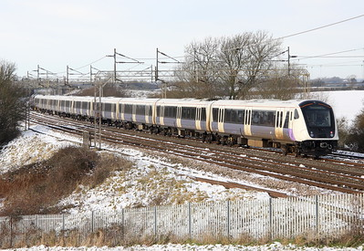 12 December 2017. Elizabeth Line branded 345018 heads away from camera behind 37601 Perseus at Chelmscote on the 5Q59 1141 Wembley - Old Dalby.