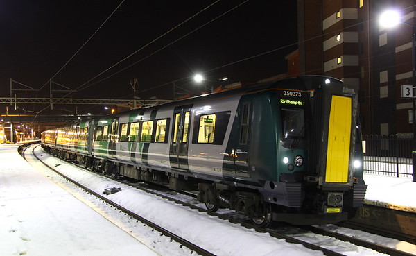 11 December 2017. Au revoir London Midland and hello London NorthWestern. The first 350 to carry the new London Northwestern livery, 350373 is seen at a -2 degrees Wolverton leading out of sight 350377 Graham Taylor OBE working her last passenger working of the day in her new colours, the 2N25 1954 Euston - Northampton.