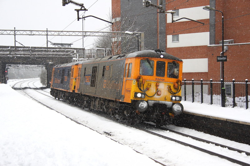 10 December 2017. Let it snow as super ED's 73963 Janice  + 73961 Alison pass through Wolverton on the fast working light as the 0Z73 1122 Tonbridge West Yard - Derby RTC.