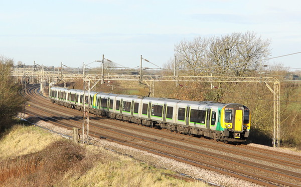 9 December 2017. London Midland duo 350121 + 350242 pass Chelmscote with the 2K14 1047 MKC - Euston. With the new London Northwestern franchise taking over the following day, note the first unit retains LM branding whilst the rear unit has been debranded