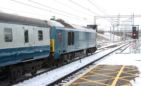 12 December 2017. Blue is the colour as 67003 complete with BR blue and grey stock stand at MK with a Chelsea footex, the 1Z59 1252 Euston - Huddersfield running an hour down.