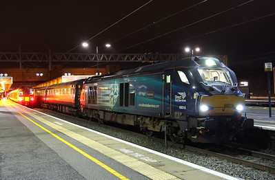 3 December 2017. With 350375 waiting to form the 2K62 2012 to Euston, 68016 Fearless comes to a stand at MK during a crew change with the Northern Belle ECS, the 5Z68 1725 King's Cross - Kidderminster SVR. Sister 68017 Hornet is on the rear. The train had been used earlier in the day for the 'Rose of the Shires - Christmas Special from King's Cross to Grantham and return.