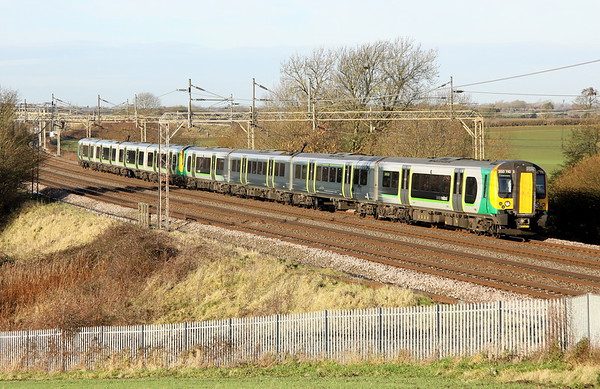 9 December 2017. On the last full day of London Midland operation, uniquely liveried 350110 + 350245 speed past Chelmscote working the 2Y64 0954 Birmingham New Street - Euston. The following day the franchise became part of the West Midlands Rail operation under the London Northwestern banner.
