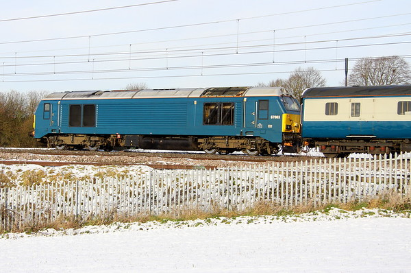 12 December 2017. A broadside view of Arriva blue liveried 67003 passing Chelmscote on the rear of 5Z59.