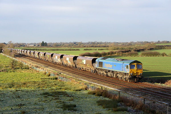16 December 2017. With overnight frost still lying in the foreground, 66623 Bill Bolsover heads past Husborne Crawley with driver Dave Smith at the controls working 6H10 0957 Bletchley RMC - Woodhouse Junction Sidings empty stone. DB Cargo have just lost the Bletchley stone traffic to Freightliner.