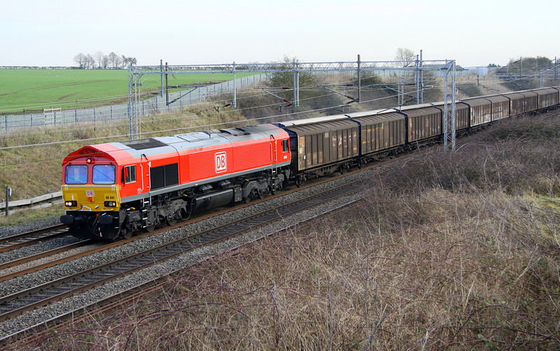 17 January 2017. A number of DB 66's have recently received full DB red livery. One such loco is 66041, seen passing Castlethorpe atop the 6M45 0706 Dollands Moor - Daventry.