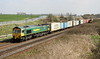 24 March 2017. 66534 OOCL Express leads the delayed 4M94 0739 Felixstowe - Lawley Street past Castlethorpe.