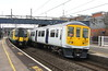 11 March 2017. Nearly twenty years of design separate classes 319 and 350. With 350242 forming the rear of the 1017 to Euston at Wolverton, 319362 and 319448 (out of sight) head north with the 5N36 1002 Wolverton Centre Sidings - Allerton TMD.