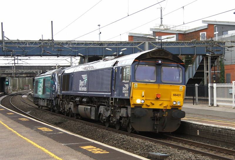 4 March 2017. 66431 is seen passing Wolverton dragging failed 68021 Tireless heading for Crewe Gresty Bridge. 68021 had worked from Norwich to Willesden the previous day and then continued on to Crewe on 4 March but encountered problems with coolant and overheating at Leighton Buzzard. 68021 eventually stumbled to Bletchley loop before being declared a failure. 66431 was scrambled from Crewe to collect the errant 68 for onward movement to Cheshire.