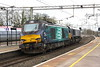 4 March 2017. Tireless gets a helping hand from 66431 passing Wolverton.