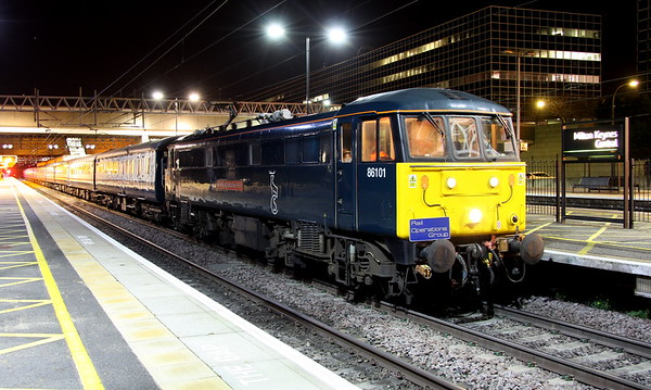 25 November 2017. Complete with ROG headboard, Caledonian sleeper liveried 86101 Sir William A Stanier FRS calls briefly at MK with the return leg of a Chelsea footex, the 1Z73 2040 Liverpool South Parkway - Euston.