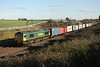 27 October 2017. Creeping shadows as 66526 Driver Steve Dunn (George) passes Castlethorpe leading the delayed 4M94 0739 Felixstowe - Lawley Street.