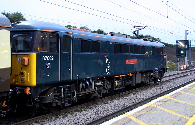 7 October 2017. 87002 Royal Sovereign stands at MK heading 'The Caledonian', the 1Z50 0610 Euston - Glasgow Central. The seven worked as far as Crewe from where 50007 + 50049 took over to Scotland.
