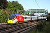 15 September 2017. 390010 The Cumbrian Spirit has become the first Pendolino to gain a revised livery applied at the new Alstom Widnes facility. On her first revenue earning run, 390010 passes Bradwell and catches the sun on the final few metres of the 1R19 0700 Liverpool Lime Street - MKC. All Virgin services were being truncated at MKC due to the fire at a timber yard at Headstone Lane in North London.