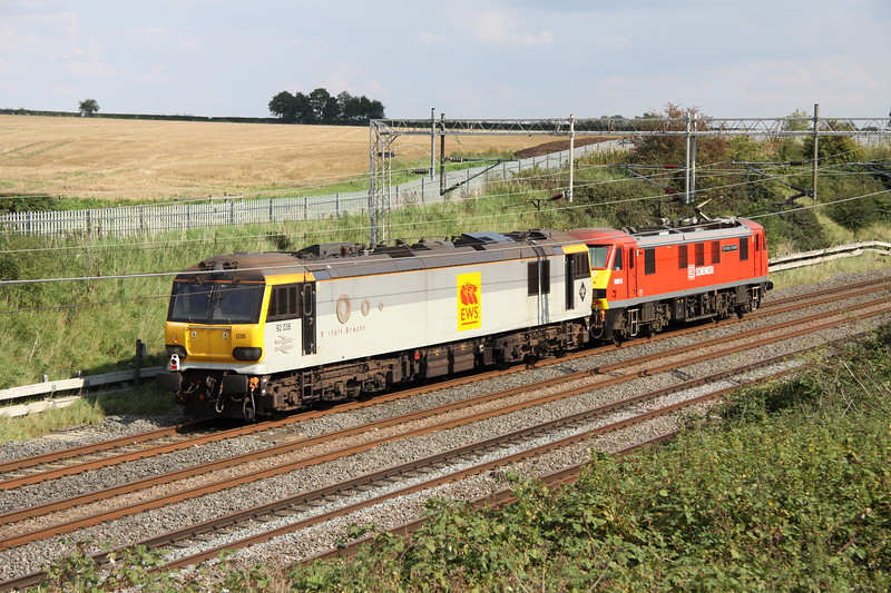 1 September 2017. 90018 The Pride of Bellshill has 92036 Bertolt Brecht for company as the duo pass Castlethorpe with the 0A06 1335 Crewe IEMD - Wembley loco move.