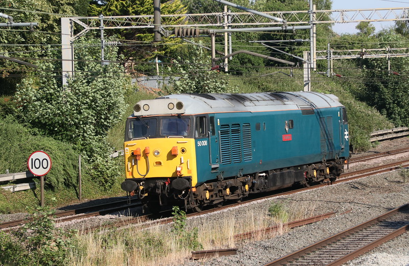 5 July 2018. 50008 Thunderer hoovers up the ground passing Castlethorpe whilst working light as the 0L28 1651 Wembley - Leicester LIP. She had ventured up from Willesden to Claydon Junction and back earlier in the day.