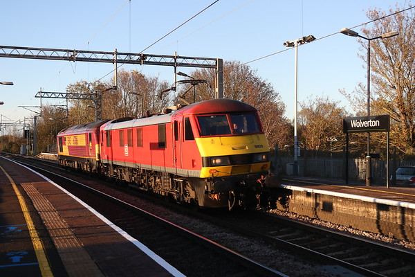 2 November 2018. The Autumn sunshine shadows just hold to witness the passage of 90029 + 67016 through Wolverton with the 0A06 1335 Crewe IEMD -Wembley.