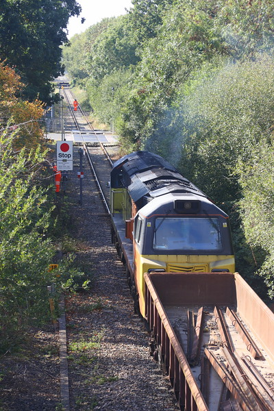 25 September 2018. 70809 stands between Charbridge Lane Crossing, Bicester and Launton with recovered rail sections working the 6C30 1810 Bicester Gavray Junction - Hinksey Yard.